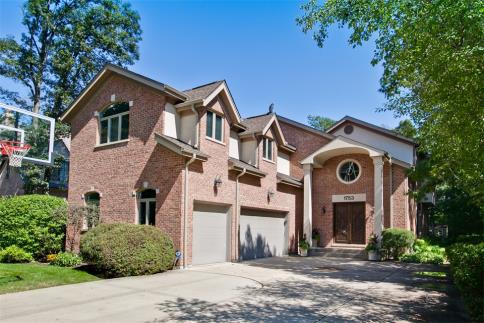 This spectacular Sherwood Forest two-story, located on sleepy Spruce Avenue, between Park Ave and Be